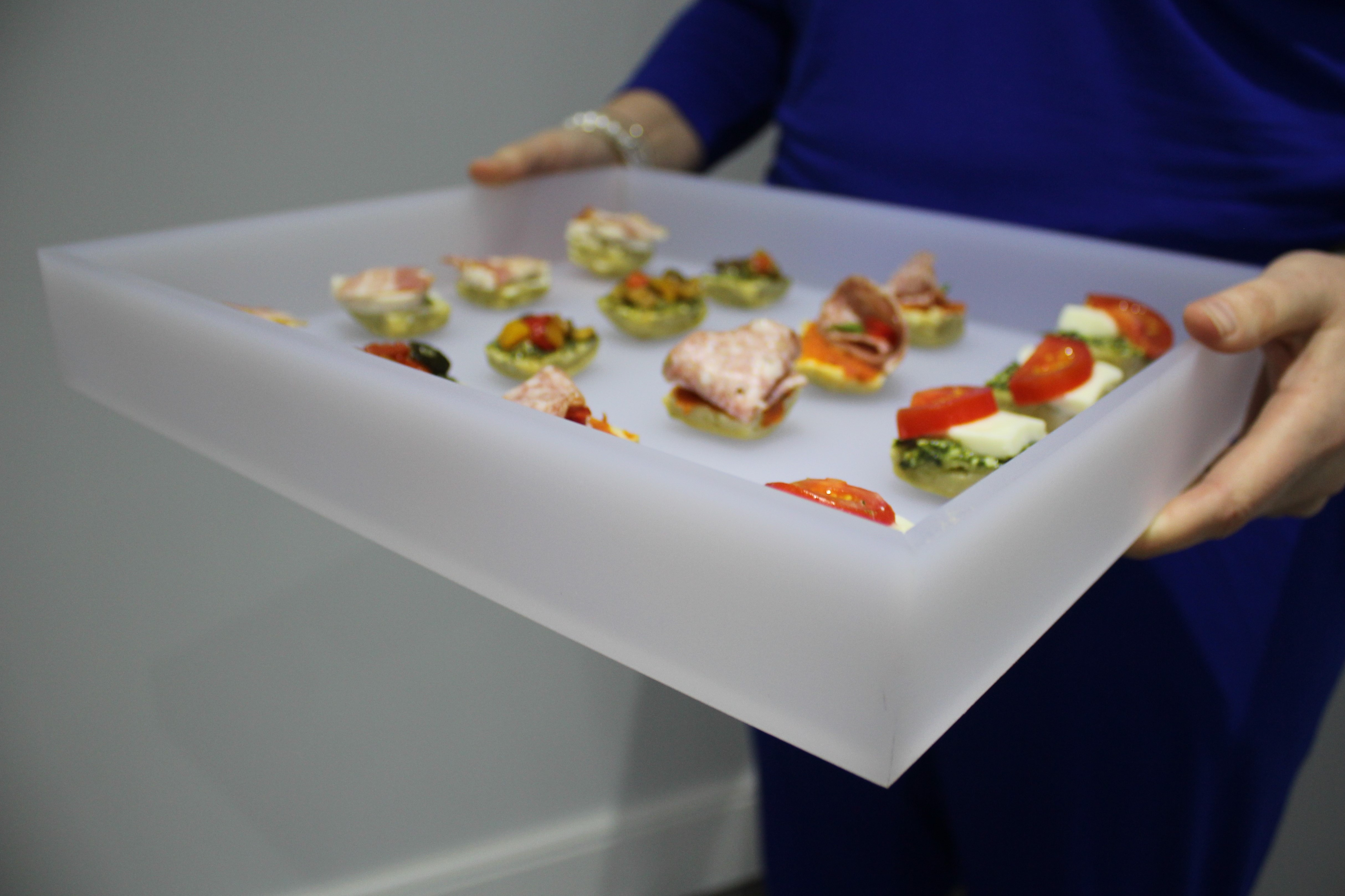 An example of an acrylic canape tray we produced